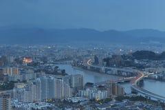 De gebouwen van Fukuoka, van Japan cityscape en het bureau stock afbeeldingen