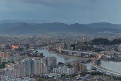 De gebouwen van Fukuoka, van Japan cityscape en het bureau stock foto's