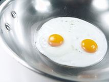 De gebraden Zonnige Kant van Eieren omhoog Stock Afbeelding