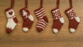 De gebreide hymnes van sokkenkerstmis Stock Foto's