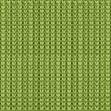 De gebreide kleur als achtergrond van groen gras Stock Foto