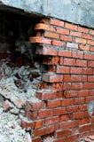 De gebroken muur van bakstenen Royalty-vrije Stock Foto's