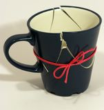 De gebroken (nu vast) Kop van de Koffie Royalty-vrije Stock Foto