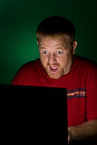 De Gebruiker die van het notitieboekje Verbaasd kijkt Royalty-vrije Stock Foto