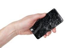 De gebruiker houdt in zijn hand gebrekkig geen naam slimme telefoon met royalty-vrije stock afbeelding