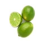 De gediende die samenstelling van het kalkfruit over wordt geïsoleerd Stock Foto's