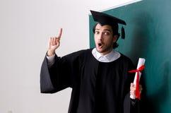 De gediplomeerde student voor groene raad stock foto