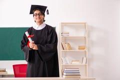 De gediplomeerde student voor groene raad royalty-vrije stock fotografie