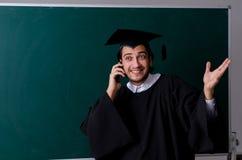 De gediplomeerde student voor groene raad royalty-vrije stock foto