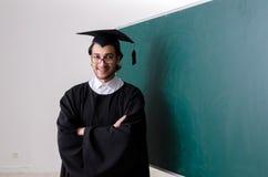 De gediplomeerde student voor groene raad royalty-vrije stock afbeeldingen