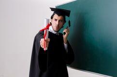 De gediplomeerde student voor groene raad royalty-vrije stock foto's
