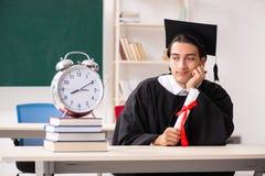 De gediplomeerde student voor groene raad stock foto's