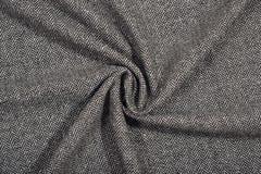 De gedrapeerde textuur van de de wolstof van de visgraattweed stock afbeelding