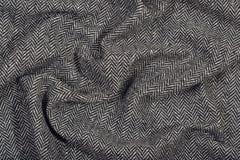 De gedrapeerde textuur van de de wolstof van de visgraattweed stock foto