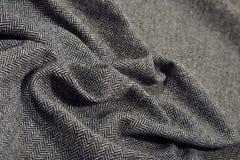 De gedrapeerde textuur van de de wolstof van de visgraattweed royalty-vrije stock foto