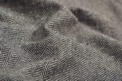 De gedrapeerde textuur van de de wolstof van de visgraattweed stock fotografie