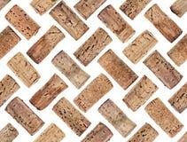 De gefotografeerde wijn kurkt op een witte backlit achtergrond Gegroepeerd als naadloos patroon, om eindeloos worden herhaald royalty-vrije stock afbeelding