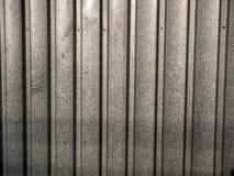 De gegalvaniseerde dicht omhoog geschotene omheining van de bladstaaltuin stock illustratie