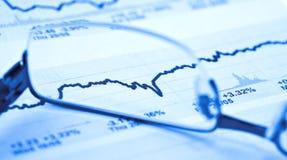 De gegevens van de markt en glazen Stock Foto's