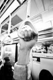 De gehouden hand van de metro - Royalty-vrije Stock Afbeeldingen