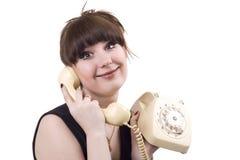 De gekke huisvrouw met telefoon. stock afbeeldingen