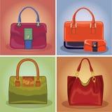 De gekleurde geplaatste handtassen van maniervrouwen Stock Fotografie