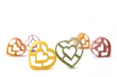 De gekleurde isolatie van hartdeegwaren Stock Foto