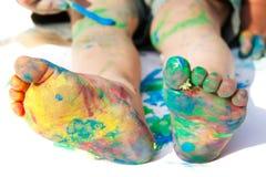 De gekleurde voeten van het kind Stock Foto