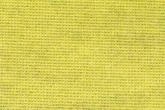 De gele achtergrond van de tafelkleedtextuur, sluit omhoog Stock Foto