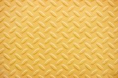 De gele achtergrond van het de plaatpatroon van de metaaldiamant Royalty-vrije Stock Foto