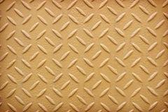 De gele achtergrond van het de plaatpatroon van de metaaldiamant Royalty-vrije Stock Foto's