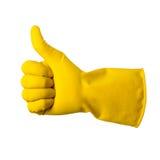 De gele handschoen voor het schoonmaken op het wapen van mensen toont geïsoleerde duimen, Stock Fotografie
