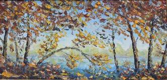 De gele herfst door het meer Stock Foto