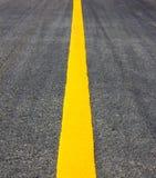 De gele lijn van de wegtextuur Royalty-vrije Stock Fotografie