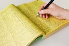 De gele pagina's van het onderzoek Stock Foto's