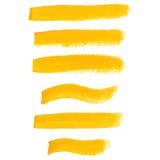 De gele slagen van de inktborstel Stock Afbeelding