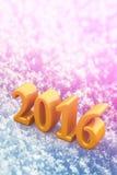 2016 de Gele Tekst van nieuwjaarkerstmis op de Sneeuw Stock Foto
