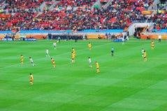 De gelijke van de voetbal op de kop van de voetbalwereld Royalty-vrije Stock Afbeeldingen