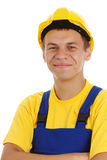 De gelukkige arbeider vouwt zijn wapens en glimlach Stock Foto's