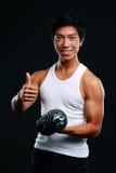 De gelukkige Aziatische domoor van de mensenholding Stock Fotografie