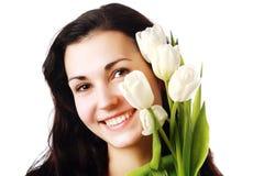 De gelukkige bloemen van de vrouwenholding Royalty-vrije Stock Foto's