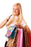 De gelukkige blonde vrouw gaat winkelend Stock Fotografie
