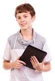 De gelukkige digitale tiener van de tabletcomputer Stock Foto