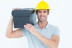 De gelukkige doos van het arbeiders dragende hulpmiddel op schouder Stock Afbeeldingen
