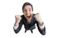 De gelukkige en vrolijke mens is opgewekt Het winnen en succesconcept Mening van hierboven stock foto