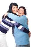 De gelukkige familie omhelst Stock Fotografie