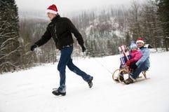 De gelukkige familie viert Kerstmis royalty-vrije stock foto