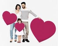 De gelukkige gevormde pictogrammen van de familieholding hart stock foto
