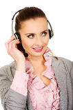 De gelukkige glimlachende exploitant van de steuntelefoon Royalty-vrije Stock Foto