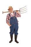 De gelukkige hogere vork van het landbouwers opheffende hooi omhoog Stock Fotografie